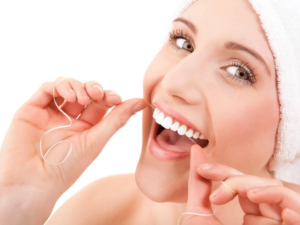 chistit-zuby-zubnoi-nitju-03